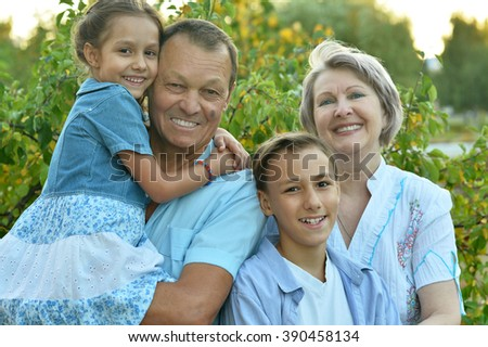 happy family relaxing in the autumn park - stock photo