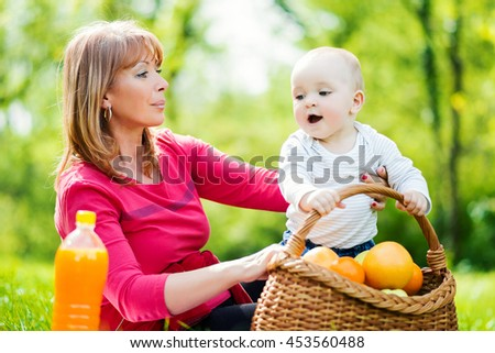 Happy family relaxing in the park. - stock photo