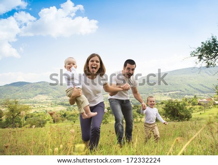Happy family relaxing together in green nature