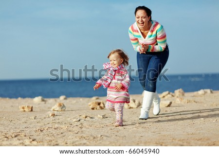 Happy family resting at beach - stock photo