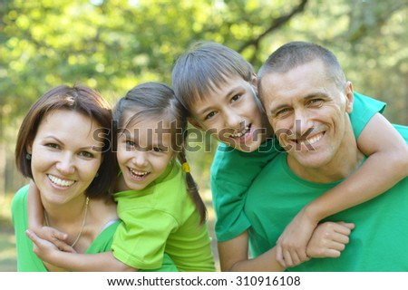 Happy Family resting in a summer park - stock photo