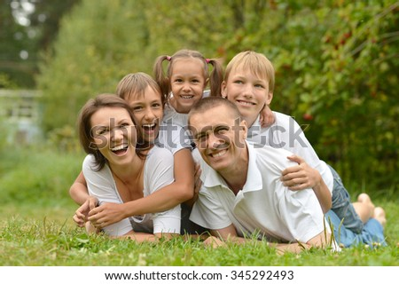 Happy Family resting in a summer park