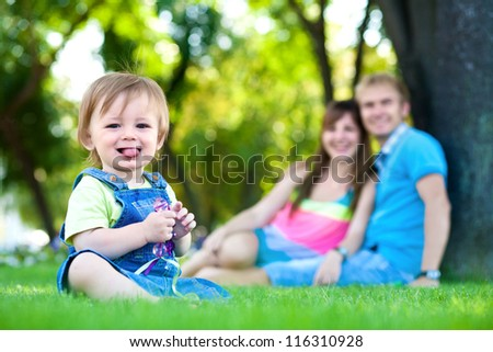 happy family resting in the summer park