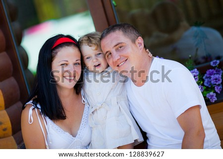 Happy family resting outdoors in summer