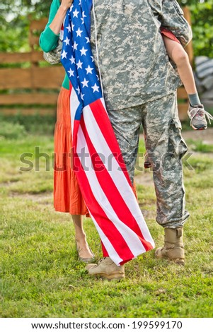 Happy family reunited, father in military uniform returns home . Us happy family portrait - stock photo