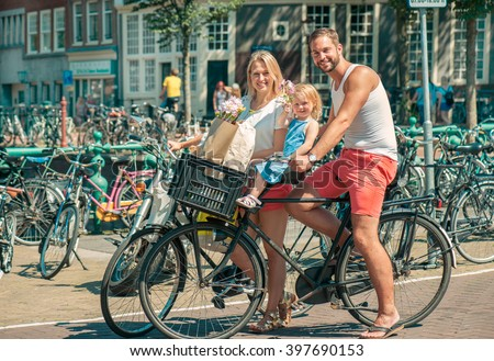 Happy family riding bikes in Amsterdam