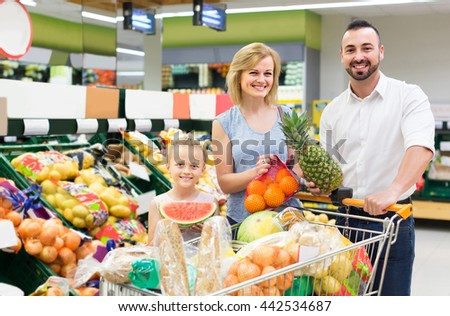 happy family shopping various fresh fruits in supermarket