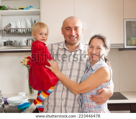 Happy family smiling at  big kitchen