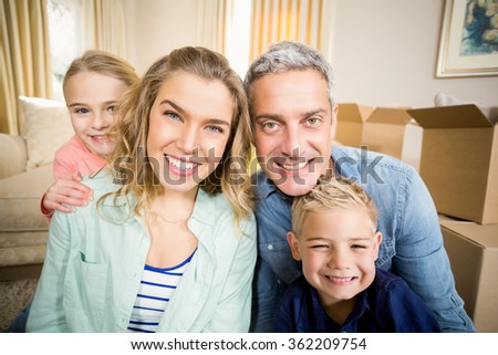 Happy family smiling in the living room - stock photo