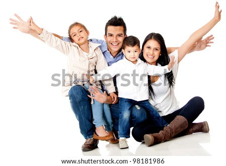Happy family smiling with arms up - isolated over a white background