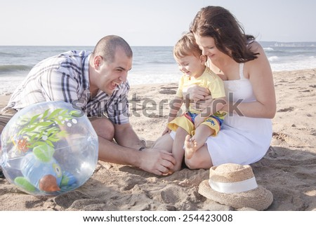 Happy family spending quality time at beach