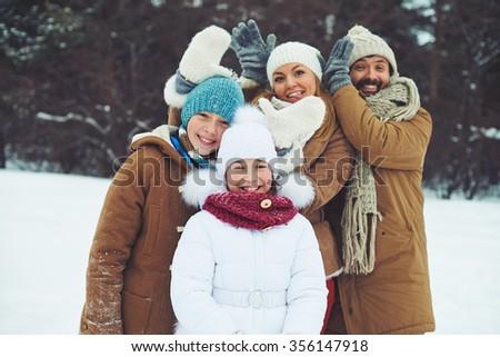 Happy family spending time together outdoors - stock photo