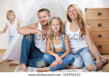 Happy family studio portrait - stock photo