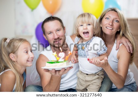 Happy family studio portrait Birthday