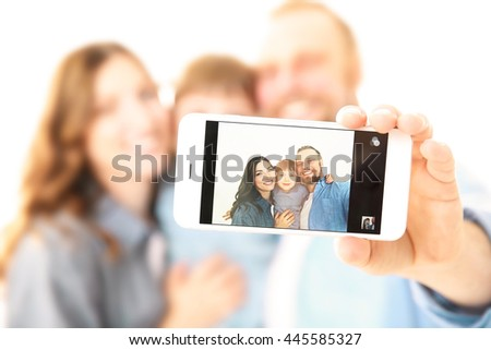 Happy family taking photo of themselves isolated on white