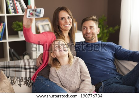 Happy family taking selfie at home  - stock photo