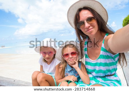happy family taking selfie at tropical beach - stock photo