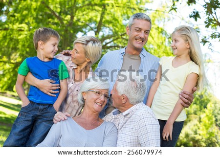 Happy family talking in the park on a sunny day