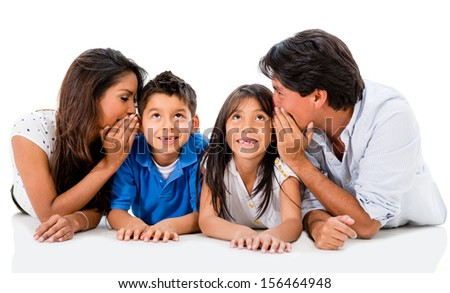 Happy family telling a secret to the ear - isolated over white  - stock photo