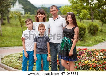 Happy family the vacationer in park