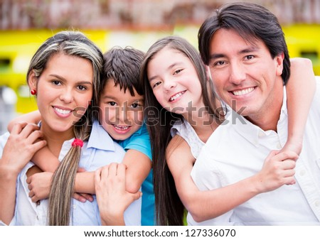 Happy family together at a restaurant and smiling - stock photo