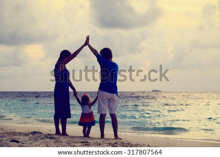 Happy family together at sunset. Mother, father and little child