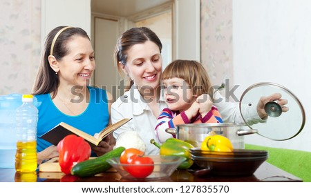Happy family together cook with vegetables in the kitchen