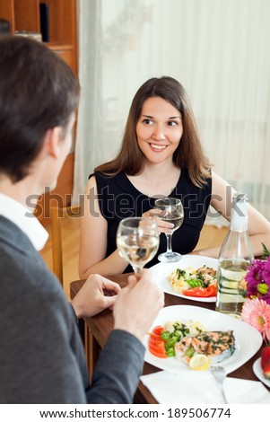 Happy family together drinking sparkling wine at romantic dinner in home interior - stock photo