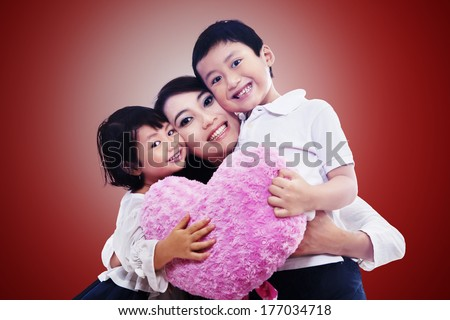 Happy family together on red background - stock photo