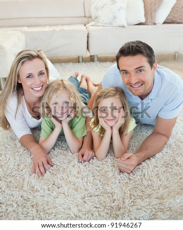 Happy family together on the floor - stock photo