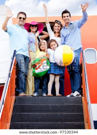 Happy family trip traveling by airplane and smiling - stock photo