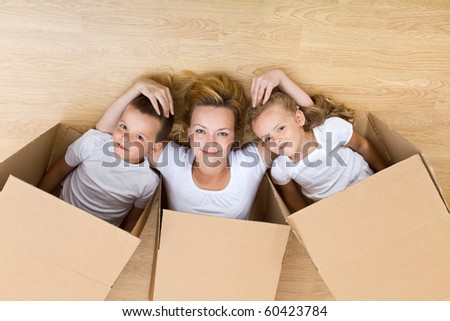 Happy family unpacking in their new home - relaxing on the floor - stock photo