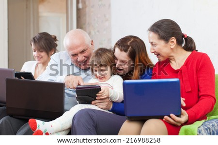 Happy family uses electronic devices in home