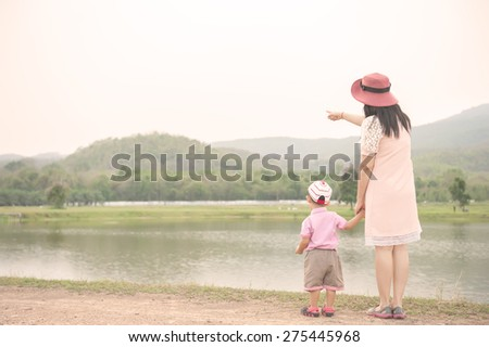 happy family Vintage tone. A mother and son playing outdoors at evening. Copy space - stock photo