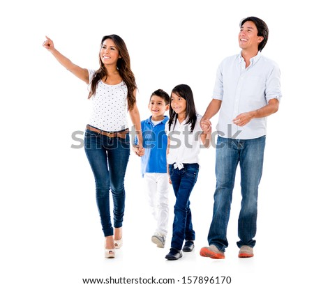 Happy family walking an pointing away - isolated over white background  - stock photo