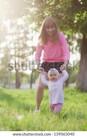 Happy family walking green field - stock photo