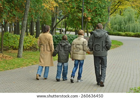 Happy Family walking in the park ,back view - stock photo