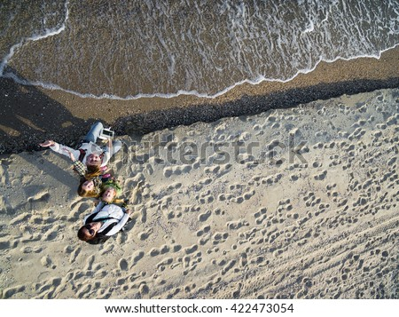 happy family walking on the beach, top view, aerial photo - stock photo