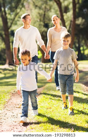 happy family walking together outdoors