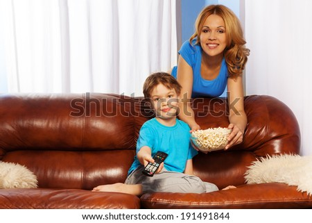 Happy family watch TV - stock photo