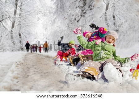 Happy family winter fun outdoors. Active parents with kids running in snowy forest