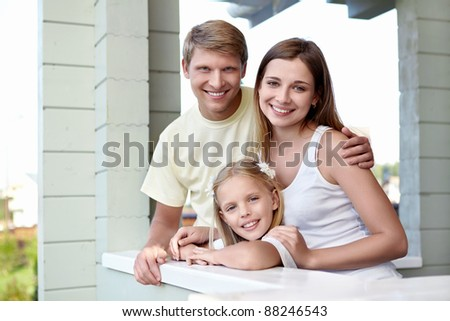 Happy family with a child - stock photo