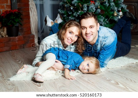 happy family with a child at home at Christmas time