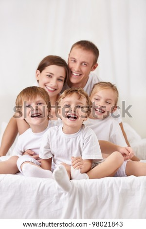 Happy family with a children in the bedroom