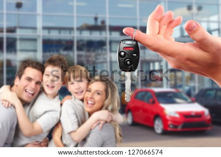 Happy family with a new car. Driving and transportation concept. - stock photo
