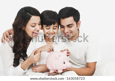 Happy family with a piggy bank