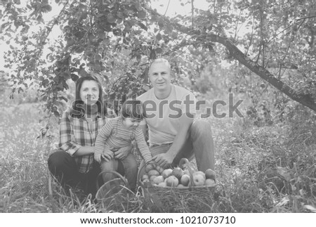 Happy  family  with apple harvest in orchard