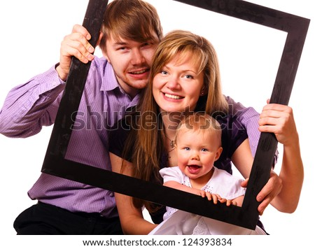 happy family with baby inside of frame on white background - stock photo