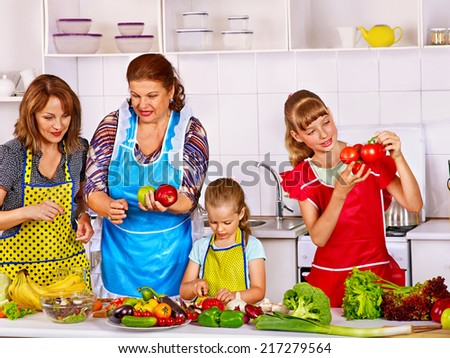 Happy family with child cooking at kitchen. Grandfather and grandmother. kitchen. - stock photo