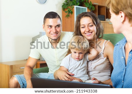 Happy family with child talking with insurance agent - stock photo